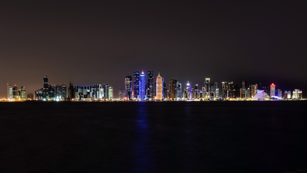 Qatar Doho night city lights water neon colors