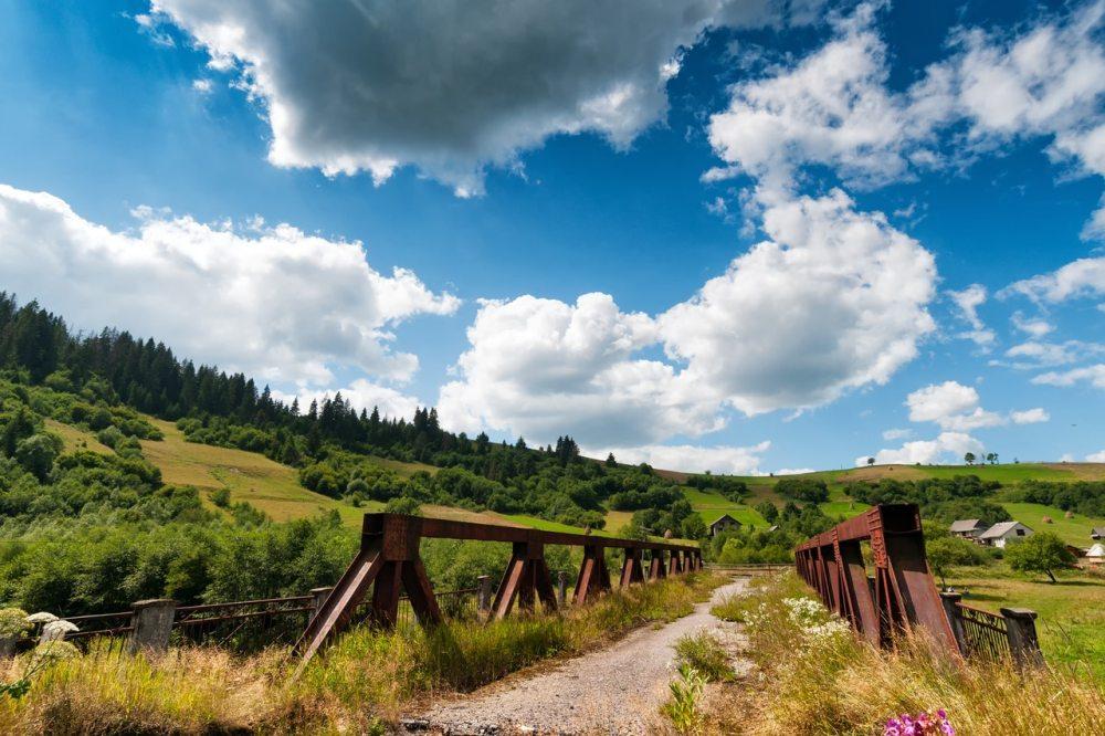 ukraine sky green fields grass blue clouds trees bridge