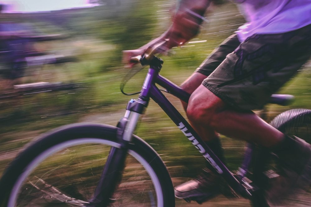 bike ride green forest blur fast free